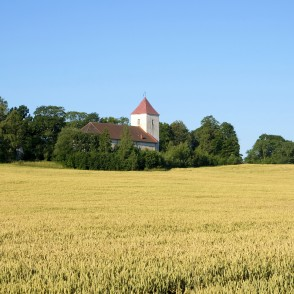 Rural landscape with Sāti Lutheran Church