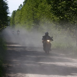 Motorcyclists bike by gravel Road