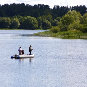 Anglers in a Boat on the River Daugava